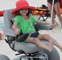 little kate enjoying a dune busting time on a motorized beach wheel chair